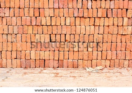 Heap of red brick on walkway - stock photo