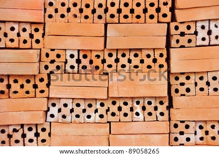 Heap of red bricks close up - stock photo
