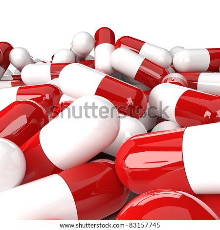 Heap of red-white capsules on a white background - stock photo