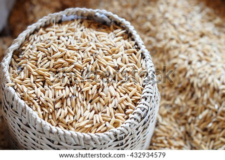 Heap of rice paddy in a basket