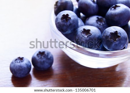 Heap of Ripe Blueberries in the Glass Bowl - stock photo