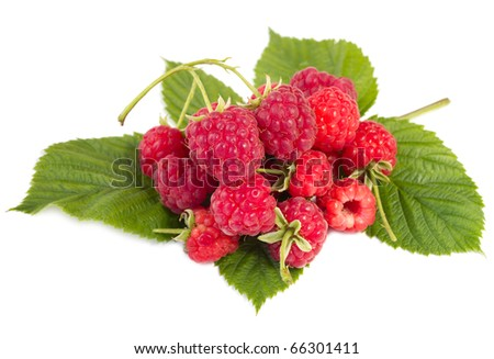 heap of ripe raspberries with leaves - stock photo