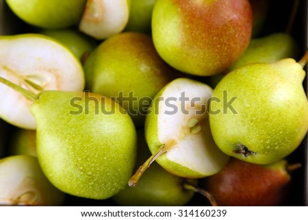 Heap of ripe tasty pears close up - stock photo