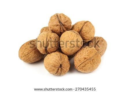 heap of ripe walnuts on white background - stock photo