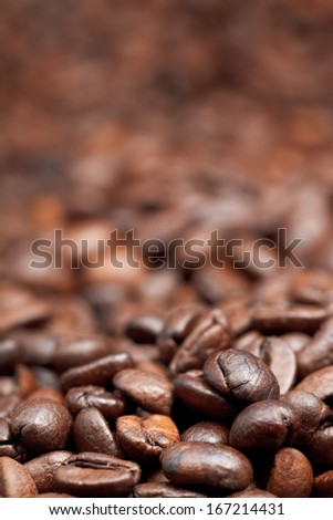 heap of roasted coffee beans background with focus foreground - stock photo