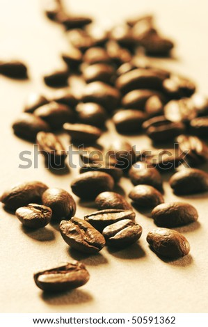 Heap of roasted coffee beans in back light.