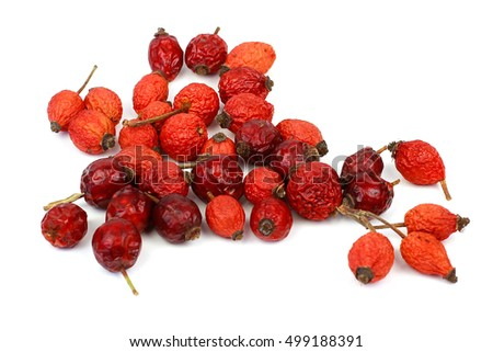 Heap of rosehips isolated on white background