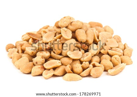 heap of salted peanuts on white - stock photo