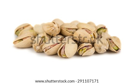 Heap of salted pistachio isolated on white background - stock photo