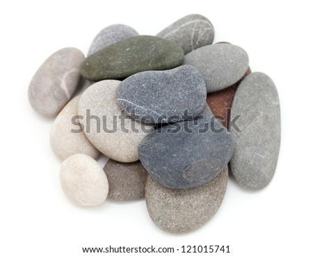 heap of sea stones isolated on white background - stock photo