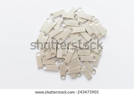 heap of silver memory sticks on white - stock photo