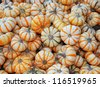 heap of striped small pumpkins - stock photo