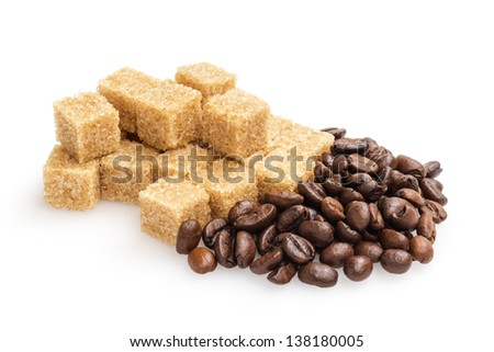 heap of sugarcane blocks and coffee beans, isolated on white background - stock photo