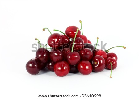 Heap of sweet cherries isolated on white - stock photo