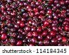 Heap of sweet red fresh cherries in a street market - stock photo