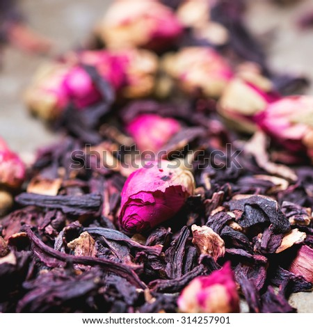 Heap of tea roses and dried hibiscus flower. Square image with selective focus - stock photo