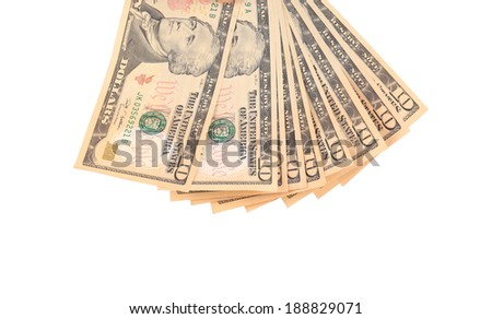 Heap of ten dollar bills. Isolated on a white background. - stock photo