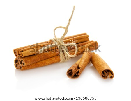Heap of the connected sticks of the cinnamon isolated on white - stock photo