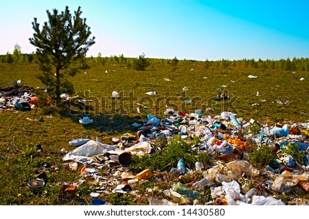 heap of the rubbish on timber glade - stock photo