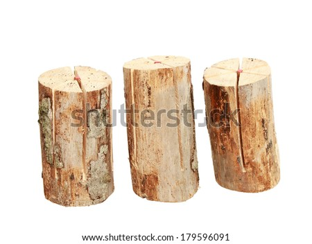 Heap of three logs with built in lighter. Isolated on a white.  - stock photo