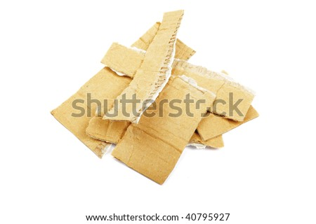 Heap of torned cardboard isolated on the white background. - stock photo