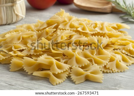 Heap of traditional Italian farfalle - stock photo