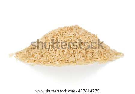 Heap of uncooked natural brown rice over white background