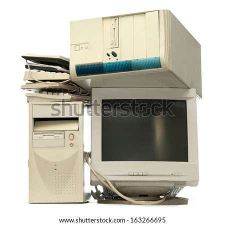 Heap of used computers and monitors - stock photo
