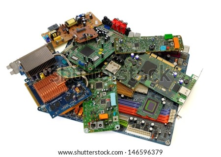 Heap of various electronic circuit boards isolated on white background - stock photo