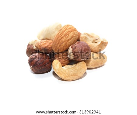 Heap of various nuts on white background - stock photo