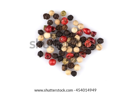 heap of various pepper peppercorns seeds mix on white