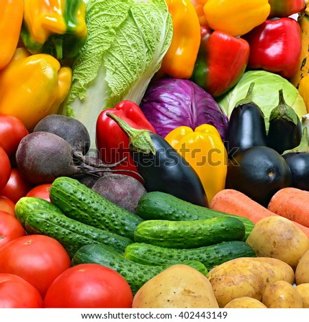 Heap of vegetables. Potatoes, tomatoes, peppers, eggplant and other vegetables. - stock photo