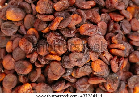Heap of very dried apricots background - stock photo