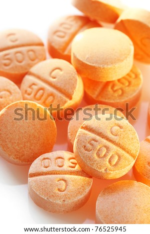 Heap of vitamin C pills close-up. - stock photo