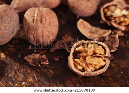 Heap of walnuts fruits in studio - stock photo