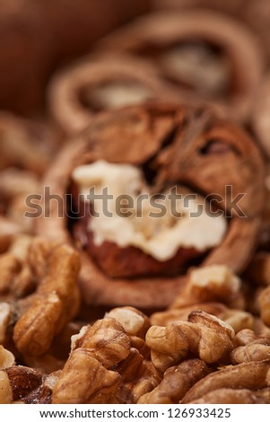 heap of walnuts full and cracked