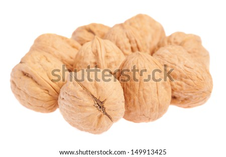 heap of walnuts isolated on a white background
