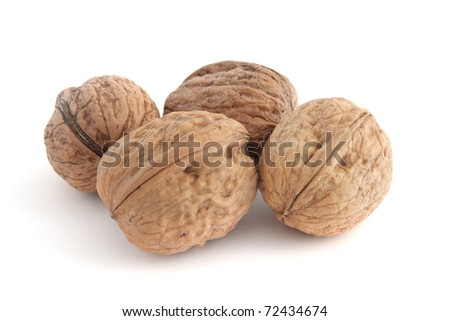 Heap of walnuts isolated on white background