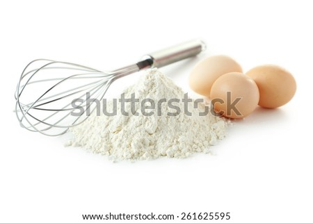 Heap of wheat flour with eggs and whisk isolated on white - stock photo