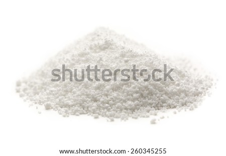 Heap of white crystal salt in closeup