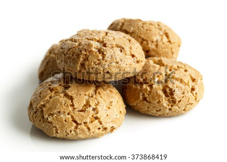 Heap of  whole Italian amaretti biscuits isolated on white in perspective. - stock photo