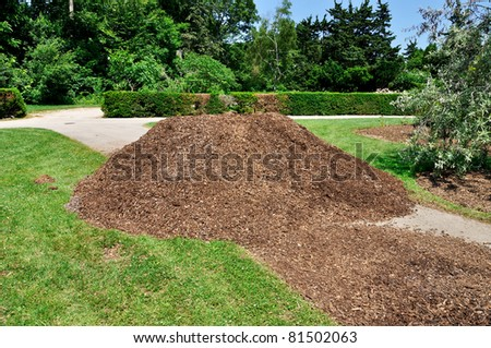 heap of wood chip as garden mulch - stock photo