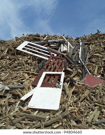 Heap of Wood Garbage in front of blue sky