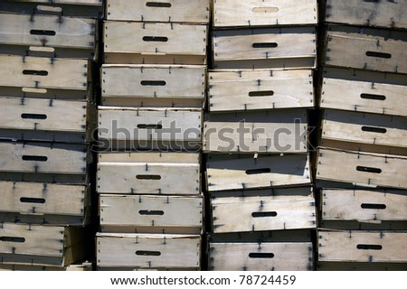 Heap of wooden boxes for storing fish