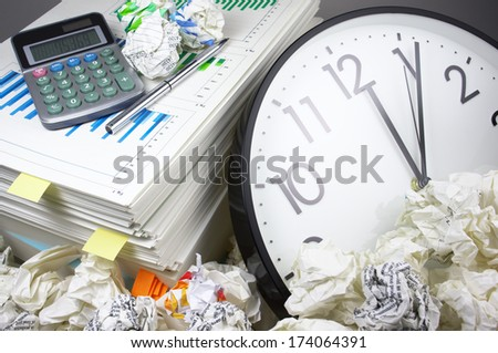 Heap of work and deadline. Stack of documents and clock.  - stock photo