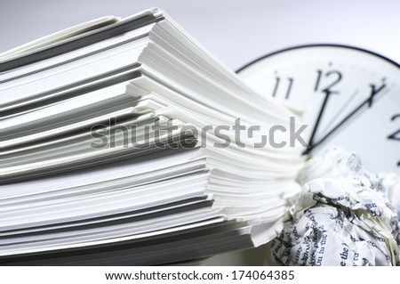 Heap of work. Stack of documents and clock.  - stock photo