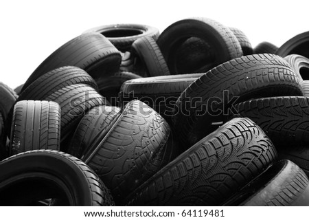 Heap of worn-out tires on white background - stock photo