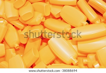 Heap of yellow plastic bottles for cosmetics