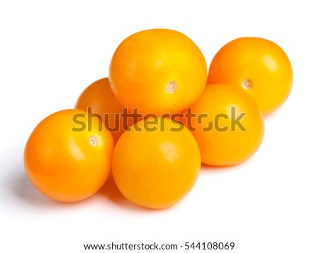Heap of yellow tomatoes isolated on white background