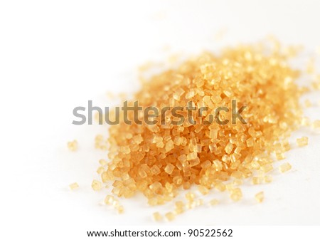 heap of yellowish brown sugar over white background - stock photo